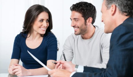 A young couple discussing with a UK partner visa consultant